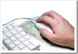 Клавіятура, гроші під мишею в руці